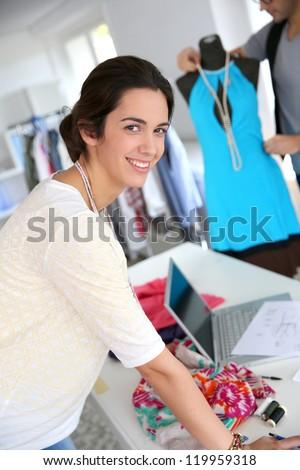 Portrait of smiling fashion designer - stock photo