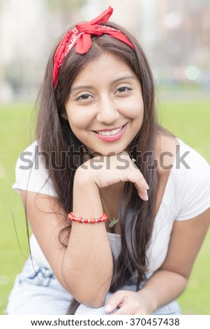 Portrait of smiling fashioner young woman, outdoor.