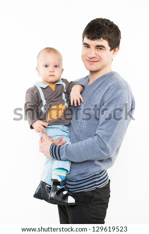 Portrait of smiling father and baby. Isolated on white background