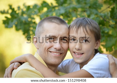 Portrait of smiling father and his son outdoors