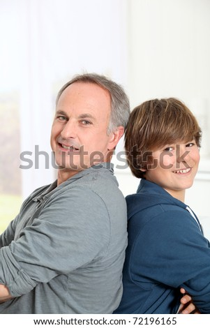 Portrait of smiling father and son - stock photo