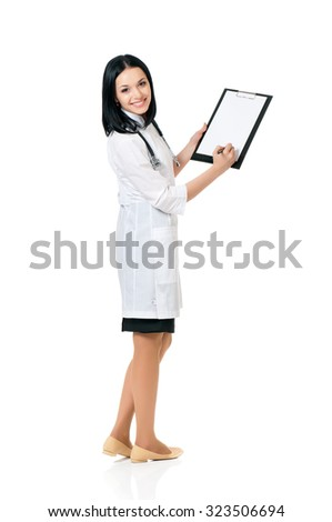 Portrait of smiling female doctor holding a clipboard - isolated over a white background - stock photo