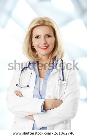 Portrait of smiling female doctor standing at medical center.  - stock photo
