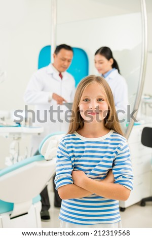 Portrait of smiling girl at dentistry - stock photo
