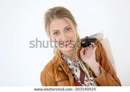 Portrait of smiling girl on a shopping day - stock photo