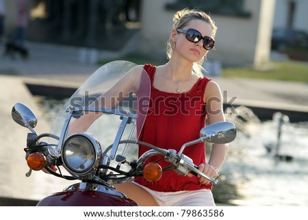 Portrait of smiling girl on scooter - Outdoor on street .Retro shot - stock photo
