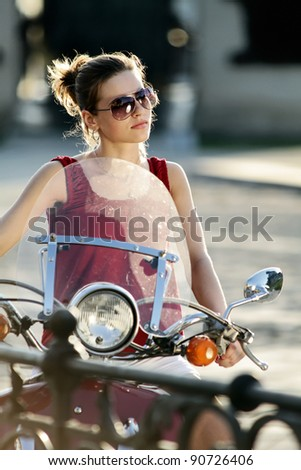 Portrait of smiling girl on scooter - Outdoor on street .Retro shot. Fashion art photo - stock photo