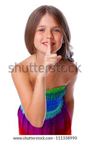 Portrait of smiling girl posing in studio - stock photo