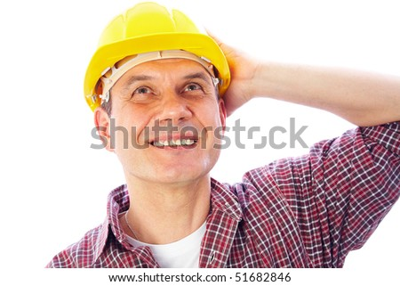 portrait of smiling handsome man-builder in helmet looking up on a white background - stock photo