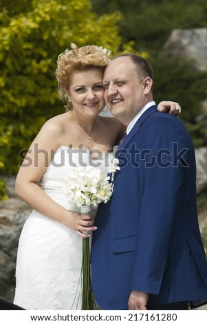 Portrait of smiling happy couple, outdoor. New family
