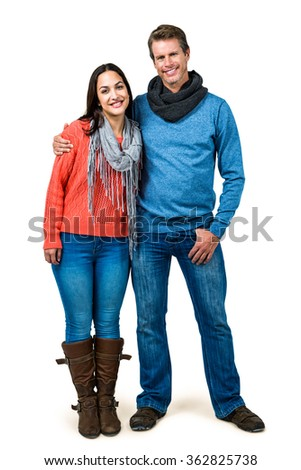 Portrait of smiling happy couple standing together against white background - stock photo