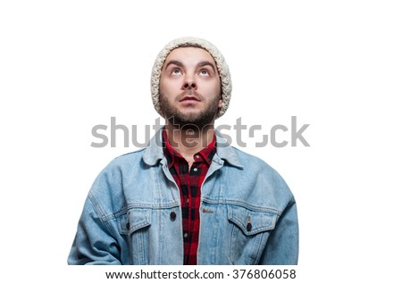 Portrait of smiling happy young man looking up - isolated on white. - stock photo