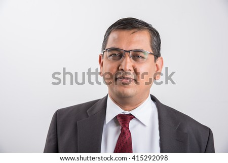 portrait of smiling indian businessman, cheerful asian businessman front profile, indian businessman isolated over white background