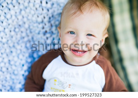 portrait of smiling infant baby in summer day