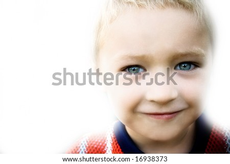 Portrait of smiling kid on white background