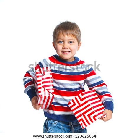 Portrait of smiling little boy with gift box, isolated on white - stock photo
