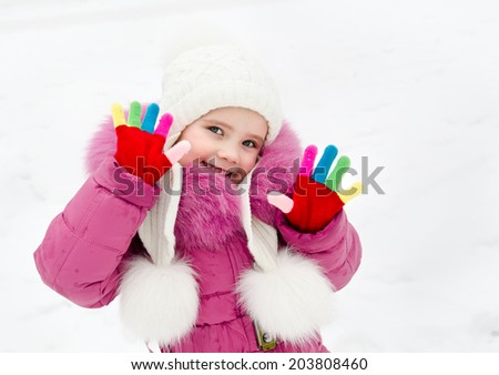 Portrait of smiling little girl in winter day outdoor