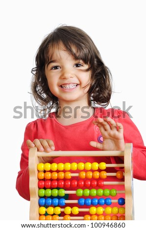 Portrait of smiling little girl with colorful abacus - stock photo