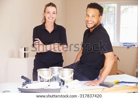 Portrait of smiling male and female decorators - stock photo