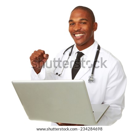 Portrait of smiling male doctor with laptop clenching fist over white background - stock photo