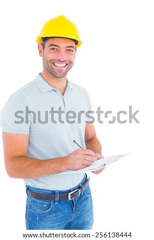 Portrait of smiling male supervisor writing on clipboard on white background - stock photo
