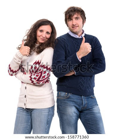 Portrait of smiling man and woman showing thumbs up sign