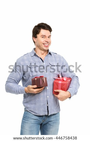 Portrait of smiling man holding gifts isolated on white background.