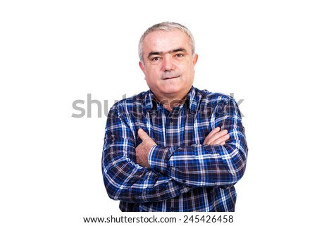 Portrait of smiling man with arms folded against white background - stock photo