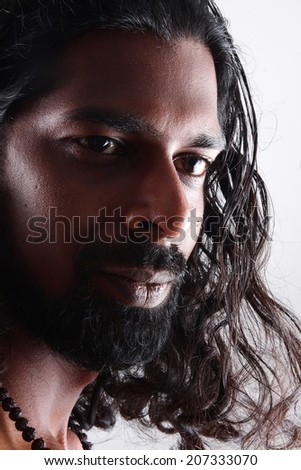 portrait of smiling man with long hair. - stock photo