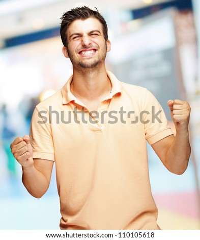 Portrait Of  Smiling Man With The Fists, Outdoor - stock photo
