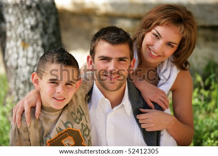 Portrait of smiling man, woman and little boy