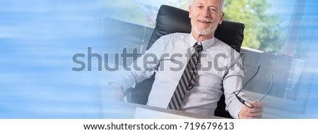 Portrait of smiling mature businessman sitting in office