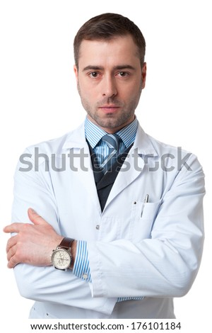 Portrait of smiling mature male doctor with crossed arms isolated on white background. Classic style in waistcoat with blue shirt and tie - stock photo