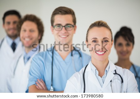 Portrait of smiling medical team in hospital - stock photo