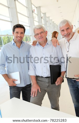 Portrait of smiling men in business training - stock photo