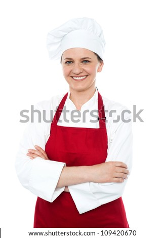 Portrait of smiling middle aged cook in uniform isolated against white background - stock photo