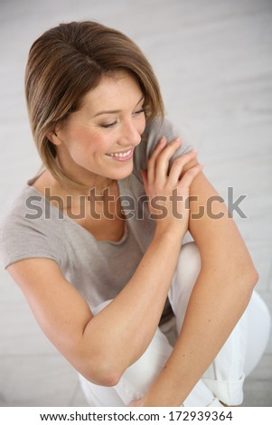 Portrait of smiling middle-aged woman - stock photo
