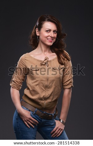 Portrait of smiling middle-aged woman in jeans. - stock photo