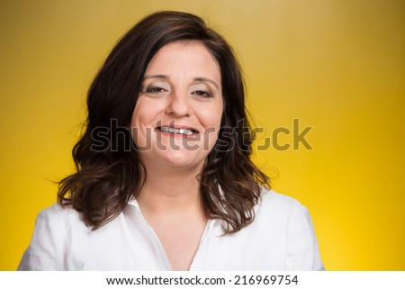 Portrait of smiling middle aged woman isolated on yellow background. Positive human emotions, facial expressions, feelings, life perception, attitude  - stock photo