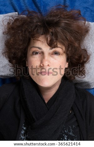 Portrait of smiling middle-aged woman top view - stock photo