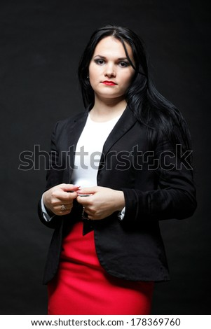 portrait of smiling modern business woman in red dress - stock photo