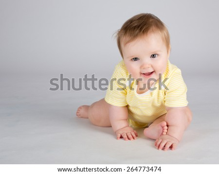 Portrait of smiling 10 months baby girl - stock photo