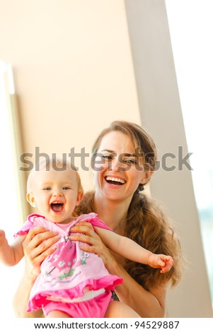 Portrait of smiling mother and baby - stock photo