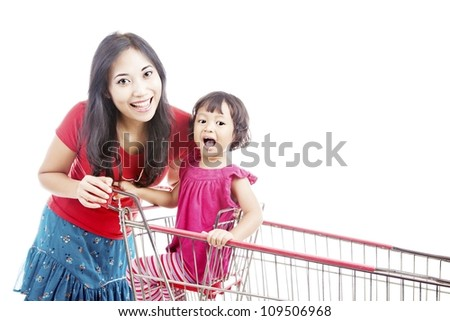 Portrait of smiling mother with her daughter in the shopping cart - stock photo
