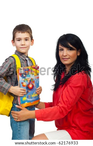 Portrait of smiling mother with her son in first day of school holding books and bag isolate don white background - stock photo