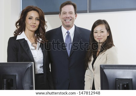 Portrait of smiling multiethnic business group standing in office