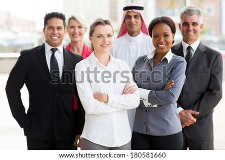 portrait of smiling multiracial business team in office - stock photo
