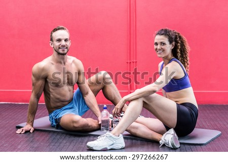Portrait of smiling muscular couple talking together