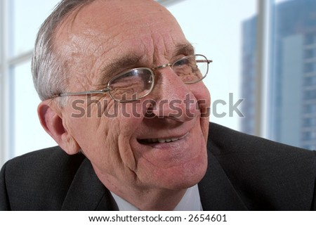 Portrait of smiling old man in glasses.