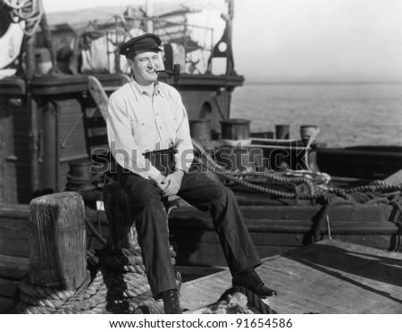 Portrait of smiling on dock near boat - stock photo